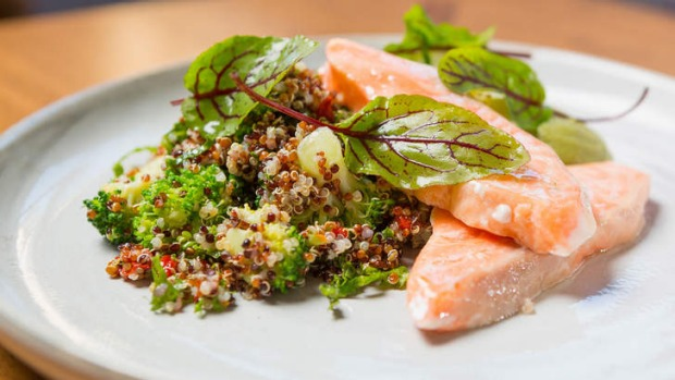 Poached ocean trout with quinoa, kale, goji berry and broccoli salad.