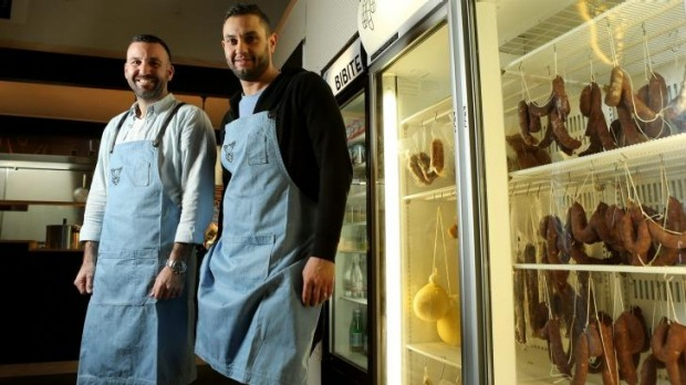 Frank Bressi (left) and Peter Mastro with their salumi fridge.