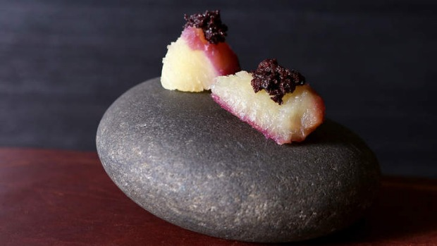 Japanese sweet potato and black olive, served on a stone.
