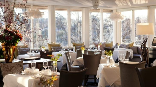 The Lake House dining room is complete with crisp white linens.
