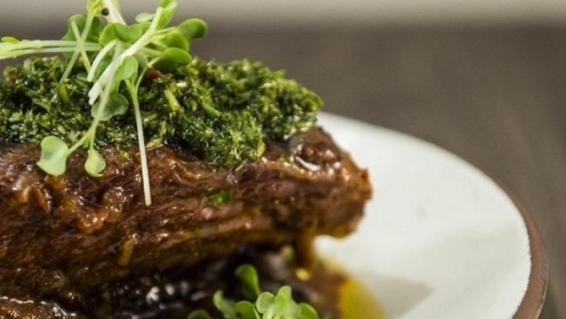 Twelve-hour slow-cooked beef short rib with black beans and chimichurri.
