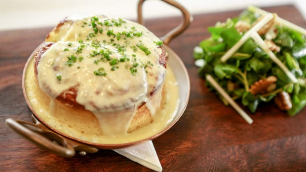 Intensely cheesy: Souffle with roquefort sauce.