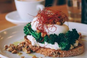 Poached eggs with spiced goat's curd and 'chilli hair'.