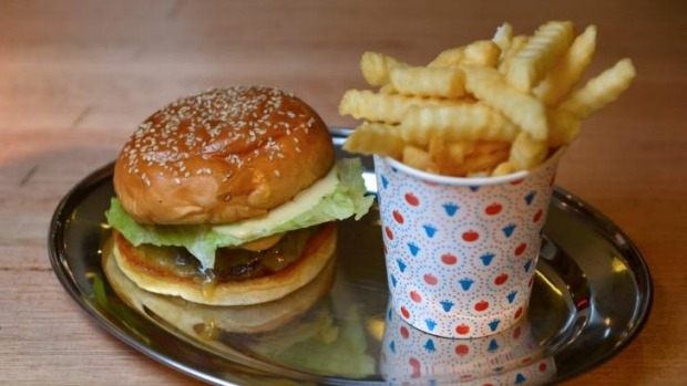 "Daniel Wilson of Huxtaburger (above) says a perfect burger ""is the sum of all of its parts""."