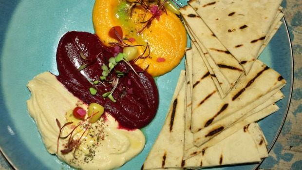 The mixed dip plate of beetroot, carrot and hummous, served with warm pita bread.