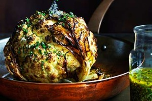 Whole roasted cauliflower with lemon and mustard dressing.