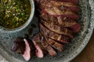 Barbecued tri-tip with coriander chimichurri.
