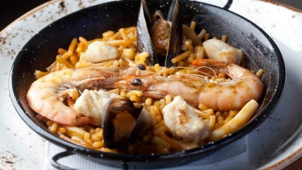 Fideua with fish, mussels and prawns.