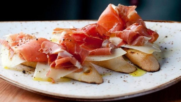 Carmen Sevilla: baguette slices rubbed with tomato and olive oil, topped with manchego and jamon.