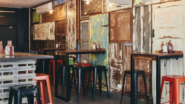 Rude Boy's feature wall is made from distressed recycled timber.