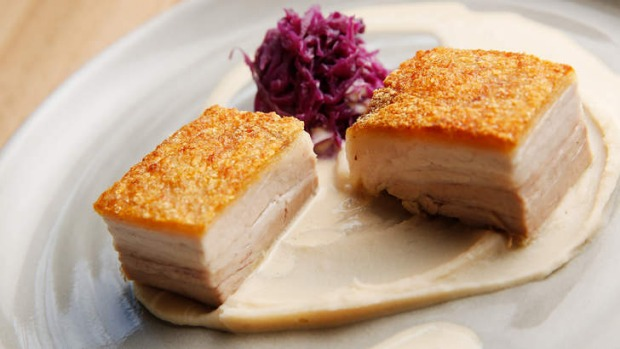 Properly crisp pork belly with white bean puree and red cabbage.