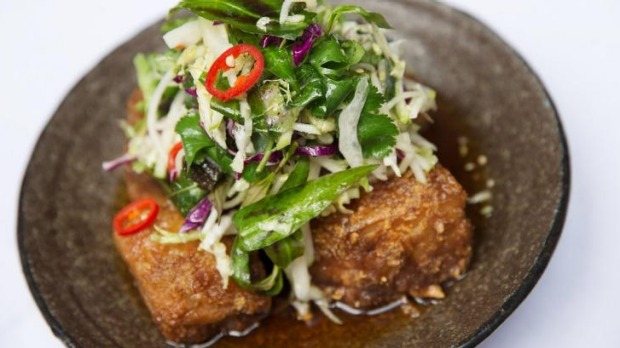 Red Spice Road's signature pork belly dish, with apple slaw, chilli caramel and black vinegar.