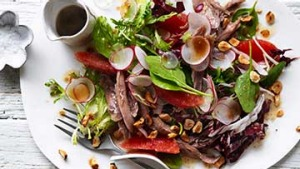 Duck salad with ruby grapefruit and hazelnuts.