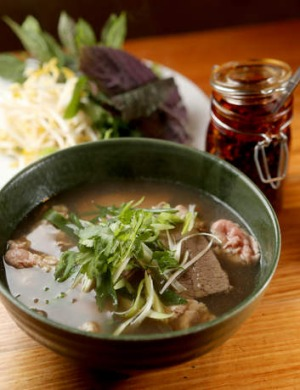 Bowled over: Beef pho is simmered for 14 hours.