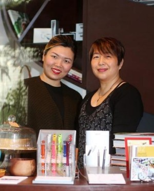 Sinmei Cheung (left) and Julie Tjiandra have partnered up to open Sinmei Tea at Scrumptious Reads.
