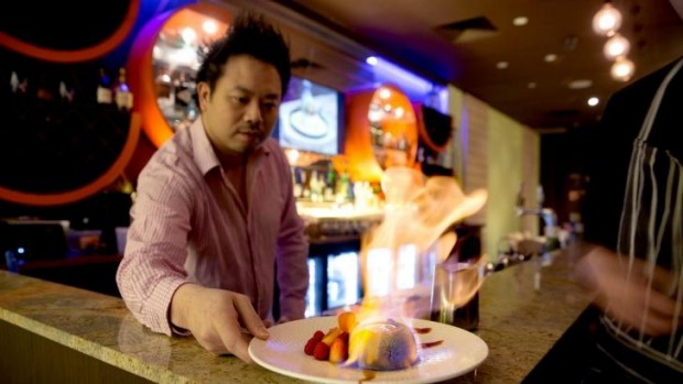 "One Tea Lounge and Grill owner David Yip presents a ""matcha lava bomb"", a dessert dish."