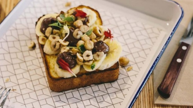 Brioche toast with Nutella, sliced banana and smashed hazelnuts.