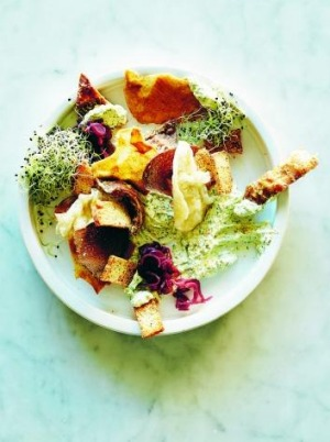 Chicken skin crackers served with salad.