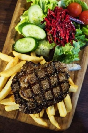 Steak with salad and fries.