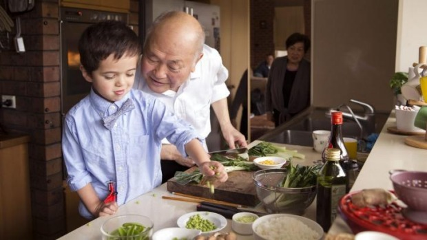 Next generation: Gilbert Lau gets a helping hand from grandson Teddy.
