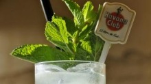 Spring fling: Give a classic mojito (pictured) a twist with some strawberry and Thai basil.