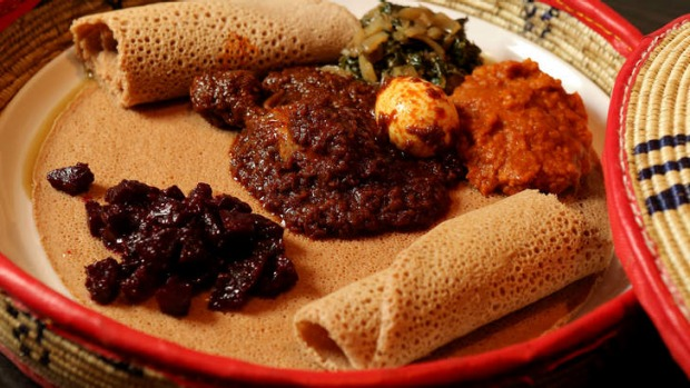 Red split lentils, chicken, diced beetroot and silverbeet served on injera bread.