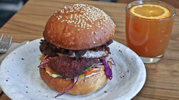 The Korean-esque fried chicken burger on a soft bun with kimchi and mayonnaise.