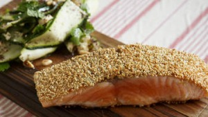 Sesame-crusted salmon with zucchini and cucumber salad.