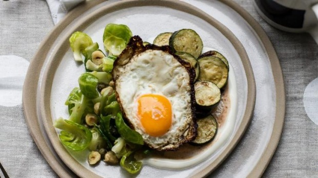 Crispy fried egg with greens.