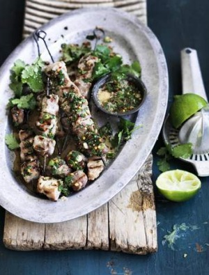 Sticky pork skewers with spiced lime dipping sauce.