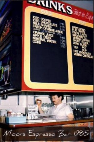 The smoking gun: the menu board showing the flat white.