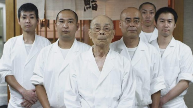Jiro Ono, centre and his son Yoshikazu Ono, directly to the right of Jiro, from Jiro Dreams of Sushi.