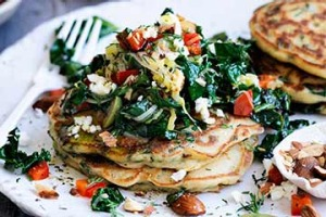 Spinach hotcakes with greens and feta.