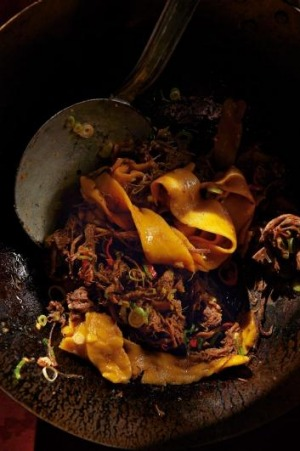 Yellow noodles with red-braised brisket.