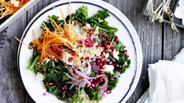 Massaged kale salad with quinoa, date and pomegranate.