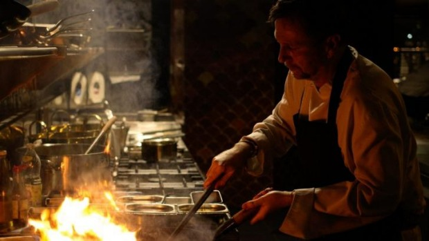 Chef David Thompson on the pans at Long Chim, Singapore.