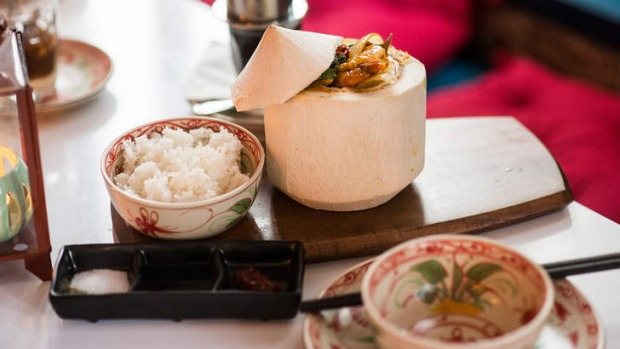 Prawn curry served in a coconut.