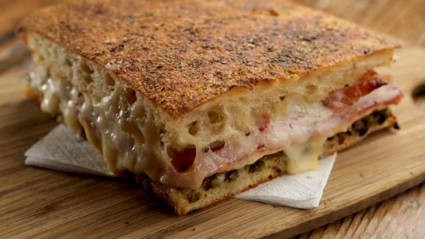 Muffaletta focaccia filled with cheese and cured meats.