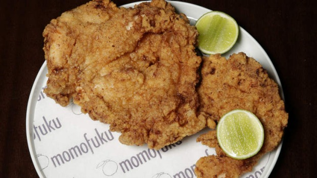 Fried chicken breast is served on the bone.