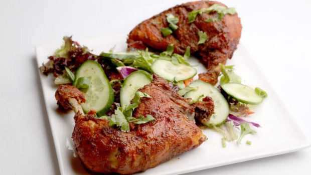 The signature Burrpie chicken is among the nearly 100 dishes on the menu.