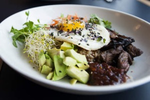 Breakfast, Muse-style: Brown rice with crisp beef tapa, sprouts, fried egg and chilli jam.