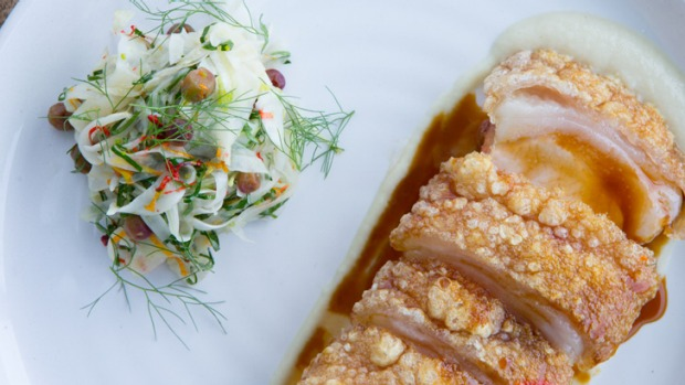 Roasted pork loin served with fennel slaw and muntrie berries.