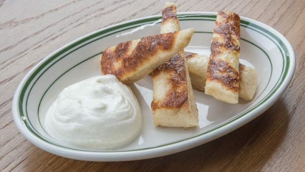 Squishy pan-fried flatbreads and fromage blanc.