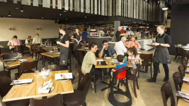 400 Gradi's Essendon dining room combines moody grey and timber.