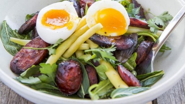 Grilled chorizo salad with soft-boiled egg and butter beans.