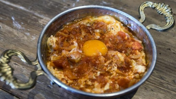 The menemen (scrambled eggs) is served in a pan.