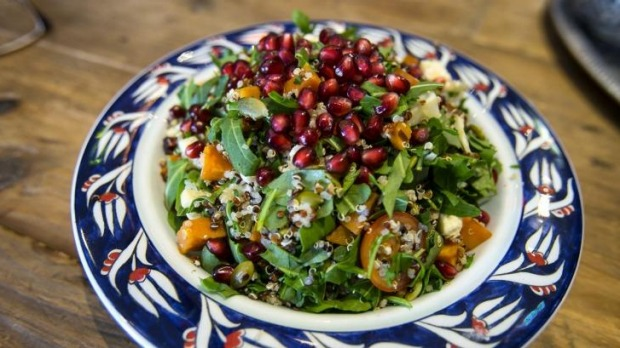 Pomegranate seeds top the quinoa salad.