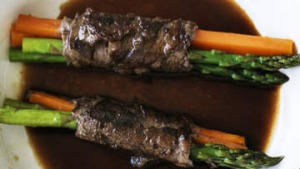 Wagyu rolls with asparagus and carrot.