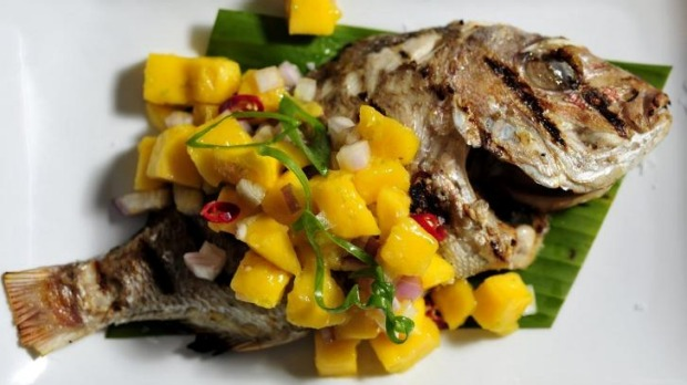 Whole baby snapper with mango salsa.