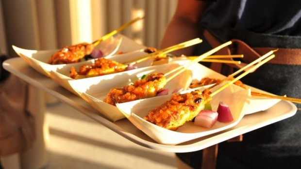 Mamak's grilled satay chicken skewers with spicy peanut sauce. Photo ...